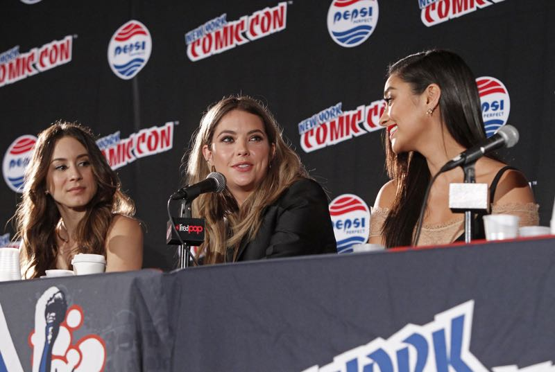"""PRETTY LITTLE LIARS - Lucy Hale, Shay Mitchell, Ashley Benson, Troian Bellisario and Sasha Pieterse as well as Executive producers Marlene King, Oliver Goldstick and Joseph Dougherty assemble at Comic-Con New York to preview the new mystery facing the girls when """"Pretty Little Liars"""" returns in January 2016. (ABC Family/Lou Rocco) TROIAN BELLISARIO, ASHLEY BENSON, SHAY MITCHELL"""