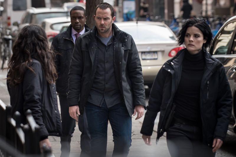 "BLINDSPOT -- ""Mans Telepathic Loyal Lookouts"" Episode 117 -- Pictured: (l-r) Rob Brown as Edgar Reed, Sullivan Stapleton as Kurt Weller, Jaimie Alexander as Jane Doe -- (Photo by: Jeff Neumann/NBC)"