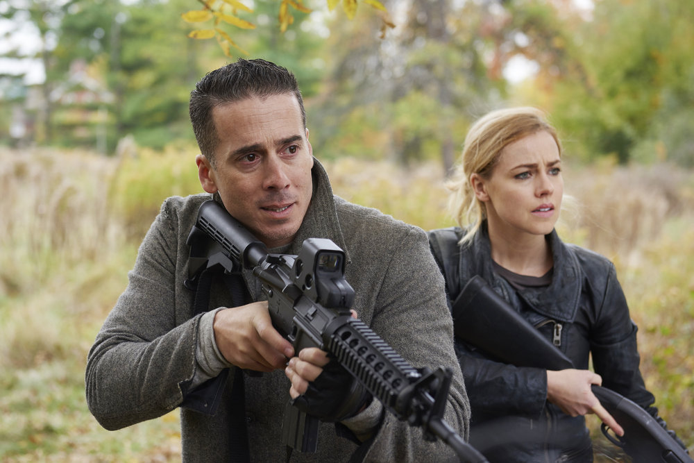 "12 MONKEYS -- ""Hyena"" Episode 209 -- Pictured: (l-r) Kirk Acevedo as Jose Ramse, Amanda Schull as Cassandra Railly -- (Photo by: Russ Martin/Syfy)"