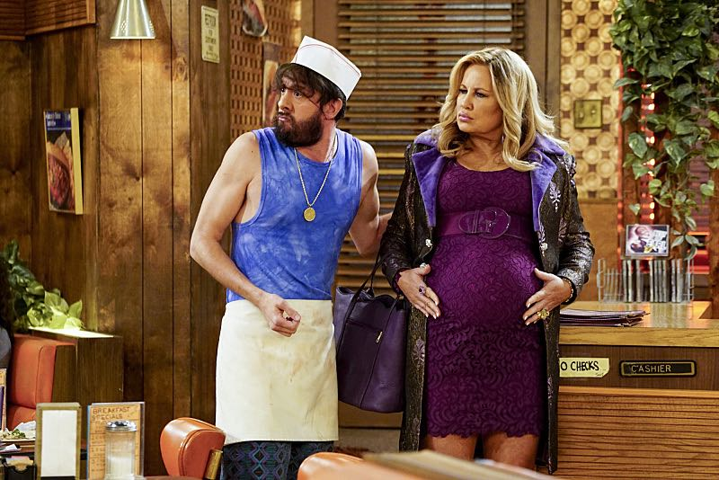 """""""And The Two Openings: Part One"""" -- Pictured: Oleg (Jonathan Kite) and Sophie (Jennifer Coolidge). As Max and Caroline, now part owners of the diner, put the finishing touches on their newly converted Dessert Bar, Max deals with the aftermath of her recent breakup with Randy, and Sophie and Oleg prepare for the birth of their baby, on the sixth season premiere of 2 BROKE GIRLS, Monday, Oct. 10 (9:00-9:30 PM, ET/PT) on the CBS Television Network. Photo: Sonja Flemming/CBS ©2016 CBS Broadcasting, Inc. All Rights Reserved"""