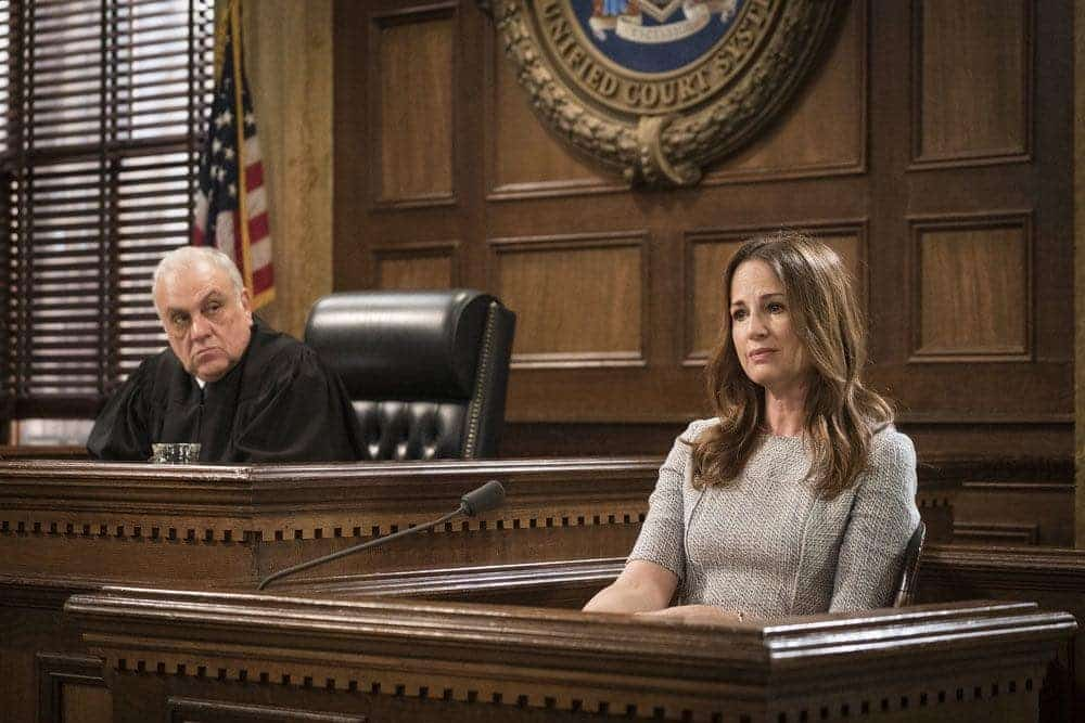 """LAW & ORDER: SPECIAL VICTIMS UNIT -- """"Imposter"""" Episode 1803 -- Pictured: (l-r) Vincent Curatola as Judge Al Bertuccio, Paula Marshall as Laura Collett -- (Photo by: Michael Parmelee/NBC)"""