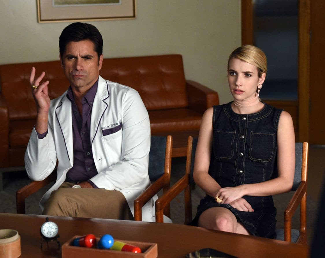 """SCREAM QUEENS: L-R: John Stamos and Rebecca Roberts in the all-new """"Handidates"""" episode of SCREAM QUEENS airing Tuesday, Oct. 11 (9:01-10:00 PM ET/PT) on FOX. Cr: Michael Becker / FOX. © 2016 FOX Broadcasting Co."""