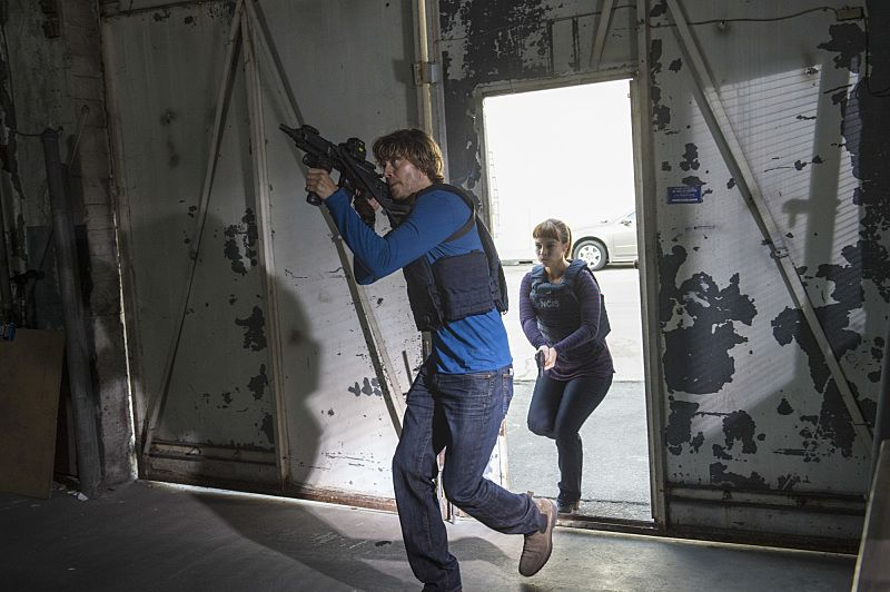 """Black Market"" -- Pictured: Eric Christian Olsen (LAPD Liaison Marty Deeks) and Renée Felice Smith (Intelligence Analyst Nell Jones). After a Homeland Security agent is poisoned by a notorious Triad assassin, NCIS uncovers a warehouse of counterfeit purses and a money trail to stolen government funds. Also, Nell joins the team in the field, on NCIS: LOS ANGELES, Sunday, Oct. 16 (8:00-9:00 PM, ET/PT), on the CBS Television Network. Photo: Neil Jacobs/CBS ©2016 CBS Broadcasting, Inc. All Rights Reserved."
