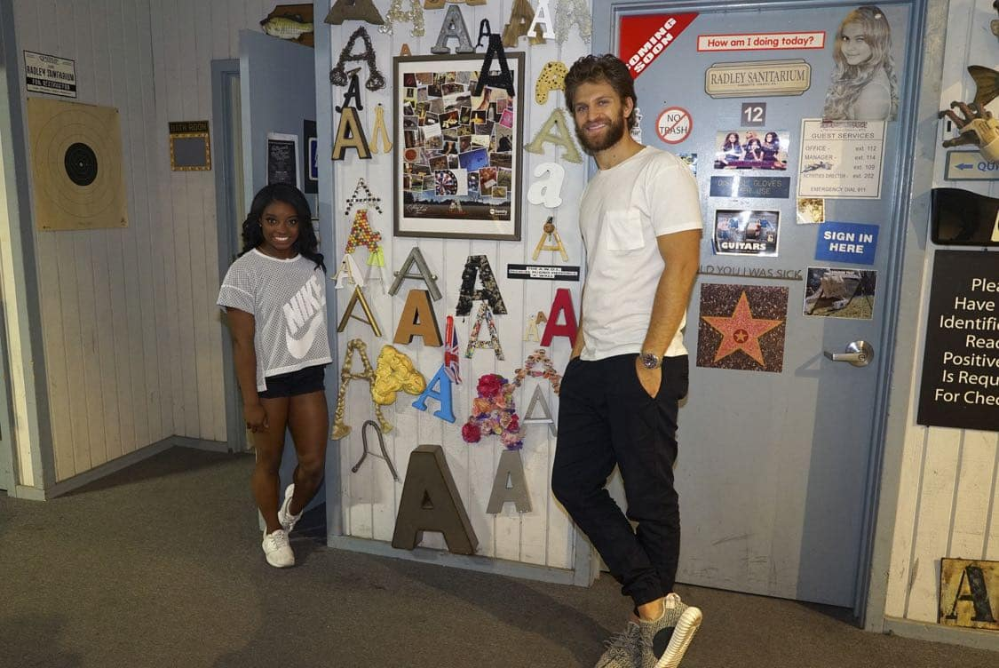 "PRETTY LITTLE LIARS - USA Olympic gold medal gymnast Simone Biles visits the set of 'Pretty Little Liars.'"" (Freeform/Byron Cohen) SIMONE BILES, KEEGAN ALLEN"