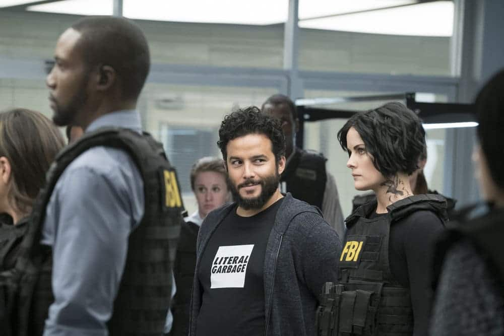 "BLINDSPOT -- ""Resolves Eleven Myths"" Episode 207 -- Pictured: (l-r) Rob Brown as Edgar Reade, Ennis Esmer as RichDot Com, Jaimie Alexander as Jane Doe -- (Photo by: Virginia Sherwood/NBC)"