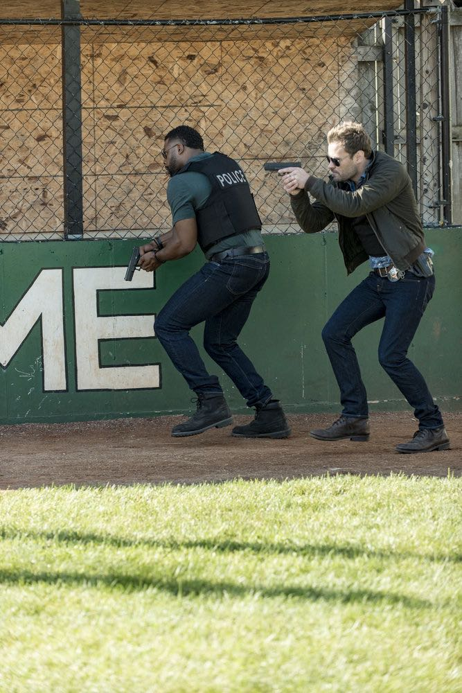 "CHICAGO P.D. -- ""Skin in the Game"" Episode 406 -- Pictured: (l-r) LaRoyce Hawkins as Kevin Atwater, Patrick Flueger as Kyle Ruzek -- (Photo by: Matt Dinerstein/NBC)"