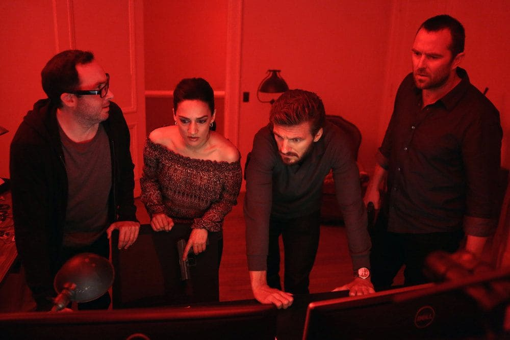 """BLINDSPOT-- """"Her Spy's Mind"""" Episode 206 -- Pictured: (l-r) P.J. Byrne as Douglas Winter, Archie Panjabi as Nas Kamal, William Connell as Mike Caruso, Sullivan Stapleton as Kurt Weller -- (Photo by: Giovanni Ruffino/NBC)"""