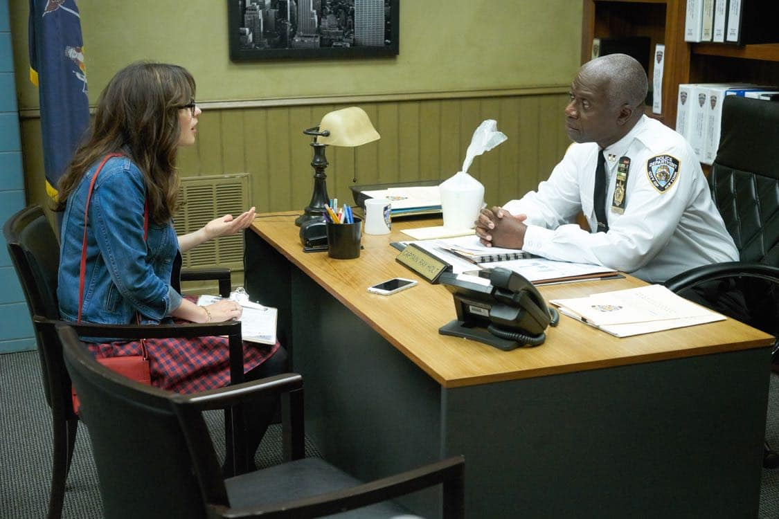 """NEW GIRL: L-R: Zooey Deschanel and guest star Andre Braugher in the special """"Homecoming"""" NEW GIRL/BROOKLYN NINE-NINE crossover episode of NEW GIRL airing Tuesday, Oct. 11 (8:31-9:01 PM ET/PT) on FOX. ©2015 Fox Broadcasting Co. Cr: Adam Taylor/FOX"""