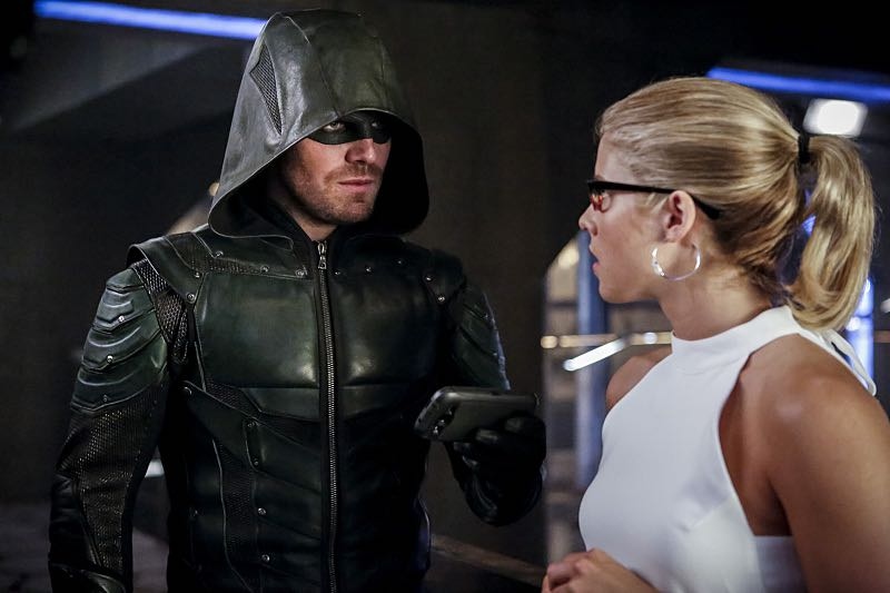 """Arrow -- """"The Recruits"""" -- Image AR502a_0219b.jpg -- Pictured (L-R): Stephen Amell as Green Arrow and Emily Bett Rickards as Felicity Smoak -- Photo: Bettina Strauss/The CW -- © 2016 The CW Network, LLC. All Rights Reserved."""