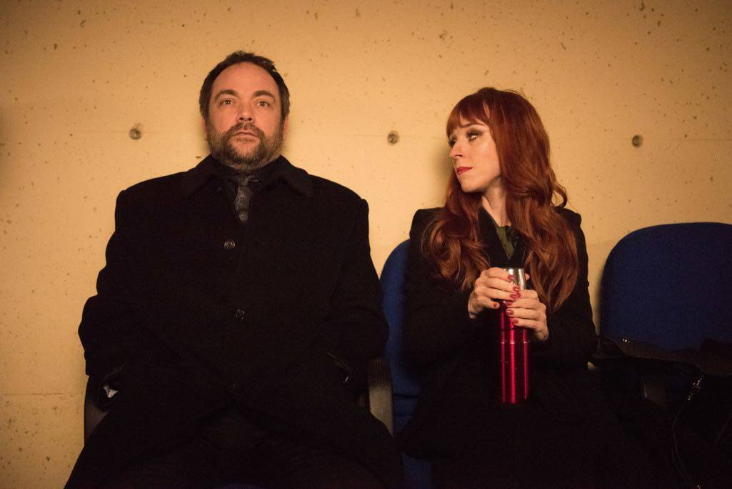 """Supernatural --""""Family Feud""""-- SN1213a_0401.jpg -- Pictured (L-R): Mark Sheppard as Crowley and Ruth Connell as Rowena"""