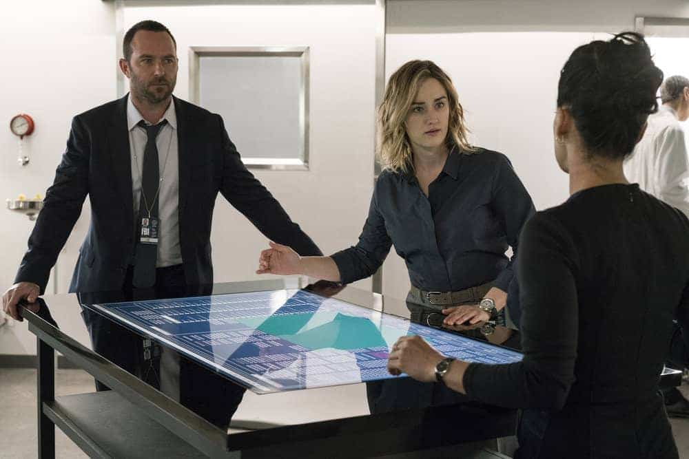"BLINDSPOT -- ""Evil Did I Dwell, Lewd Did I Live"" Episode 216 -- Pictured: (l-r) Sullivan Stapleton as Kurt Weller, Ashley Johnson as Patterson"