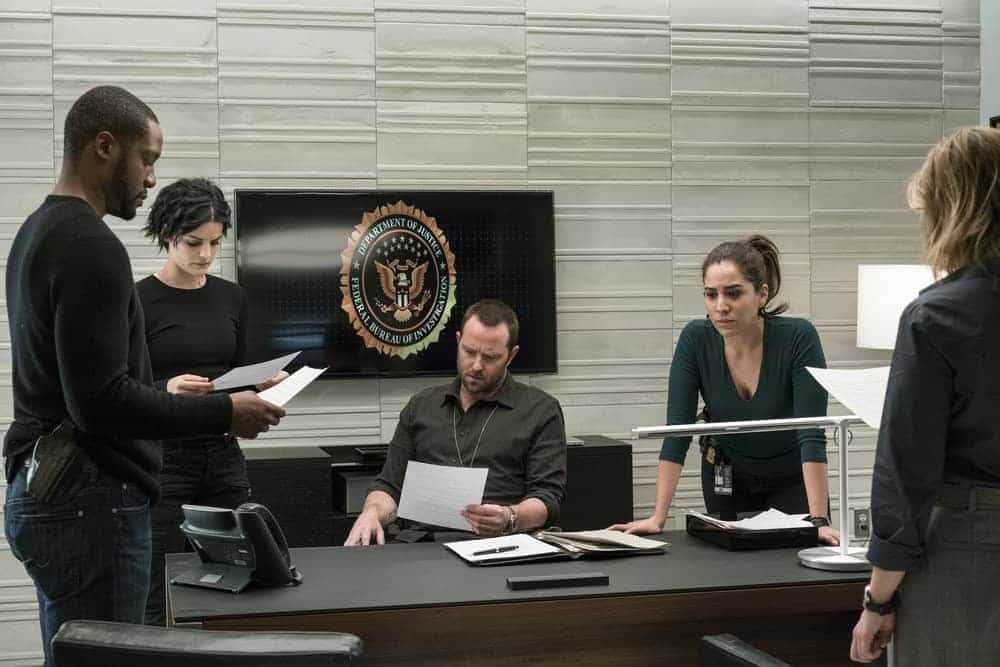 "BLINDSPOT -- ""Evil Did I Dwell, Lewd Did I Live"" Episode 216 -- Pictured: (l-r) Rob Brown as Edgar Reed, Jaimie Alexander as Jane Doe, Sullivan Stapleton as Kurt Weller, Audrey Esparza as Tasha Zapata"