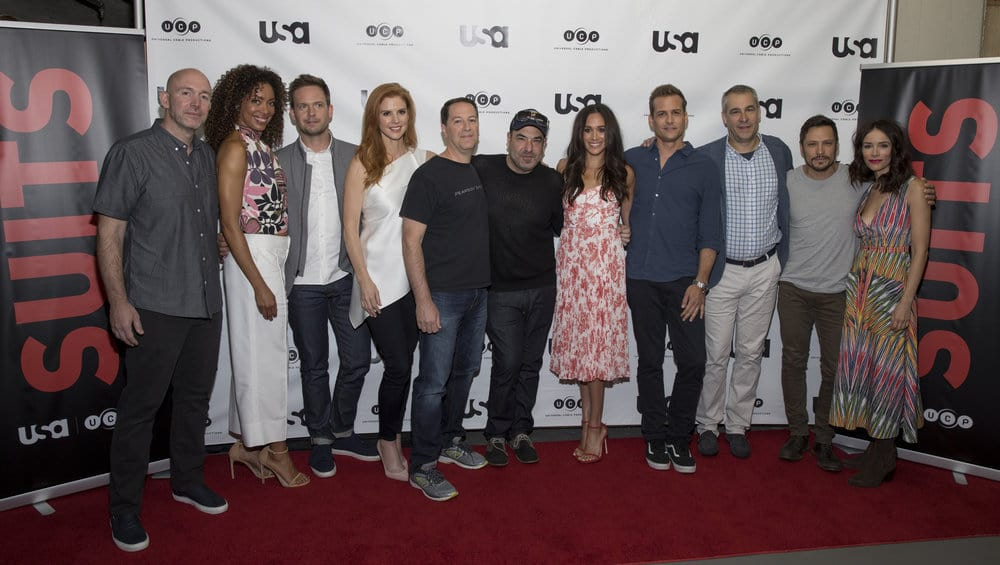 SUITS -- Script Reading Presented by USA Network -- Pictured: (l-r) Gene Klein, Gina Torres, Patrick J. Adams, Sarah Rafferty, Aaron Korsh, Rick Hoffman, Meghan Markle, Gabriel Macht, David Bartis, Nick Wechsler, and Abigail Spencer -- (Photo by: Rick Kern/USA Network)
