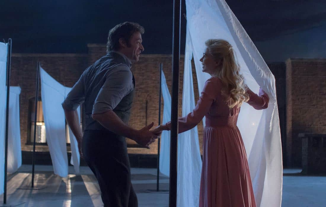 P.T. Barnum (Hugh Jackman) and Charity Barnum (Michelle Williams) share an enchanting dance on a New York rooftop in Twentieth Century Fox's THE GREATEST SHOWMAN.