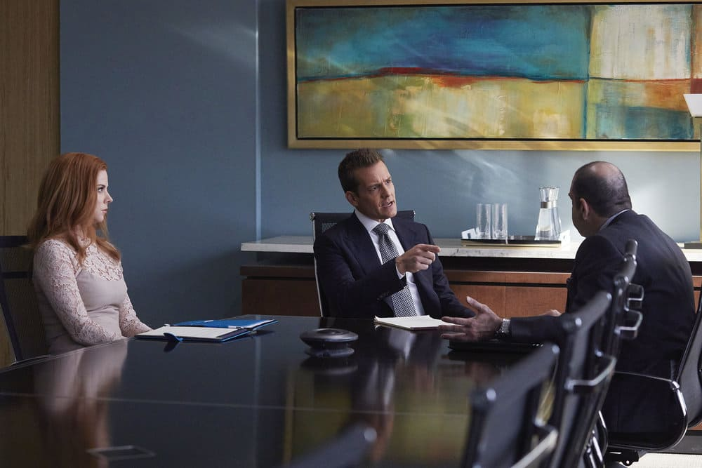 "SUITS -- ""The Statue"" Episode 702 -- Pictured: (l-r) Sarah Rafferty as Donna Paulsen, Gabriel Macht as Harvey Specter, Rick Hoffman as Louis Litt"