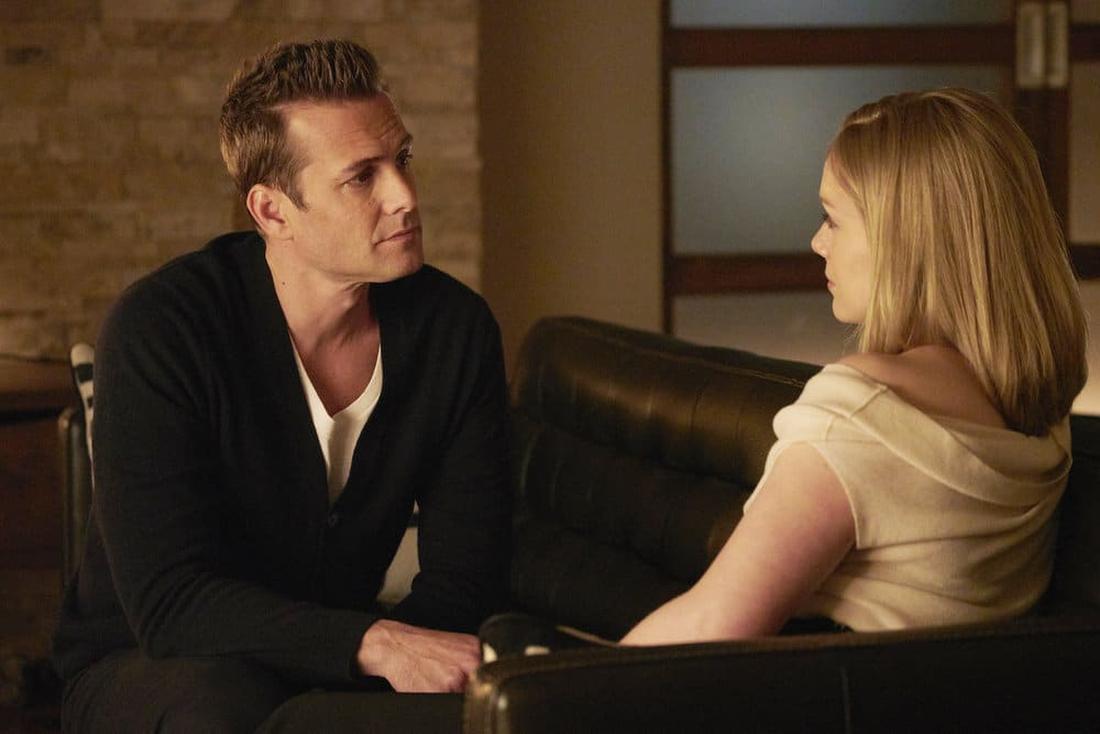 "SUITS -- ""Mudmare"" Episode 703 -- Pictured: (l-r) Gabriel Macht as Harvey Specter, Christina Cole as Dr. Paula Agard"