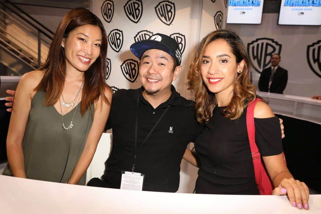 UNIKITTY! director Lynn Wang (left) and series star Eric Bauza share a snap with art director Andrea Fernandez (right) at the Warner Bros. booth at Comic-Con 2017 on Thursday, July 20. #WBSDCC (© 2017 WBEI. All Rights Reserved)