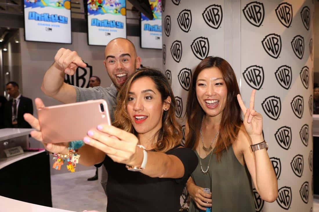 UNIKITTY! director Edward Skudder (left) gets goofy with art director Andrea Fernandez and director Lynn Wang (right) at the Warner Bros. booth at Comic-Con 2017 on Thursday, July 20. #WBSDCC (© 2017 WBEI. All Rights Reserved).
