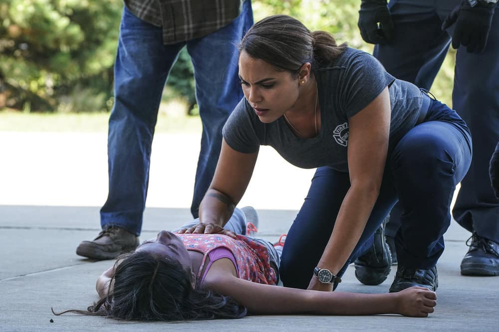 "CHICAGO FIRE -- ""It Wasn't Enough"" Episode 601 -- Pictured: (l-r) Vanessa Lynch as Little Girl, Monica Raymund as Gabriela Dawson -- (Photo by: Elizabeth Morris/NBC)"