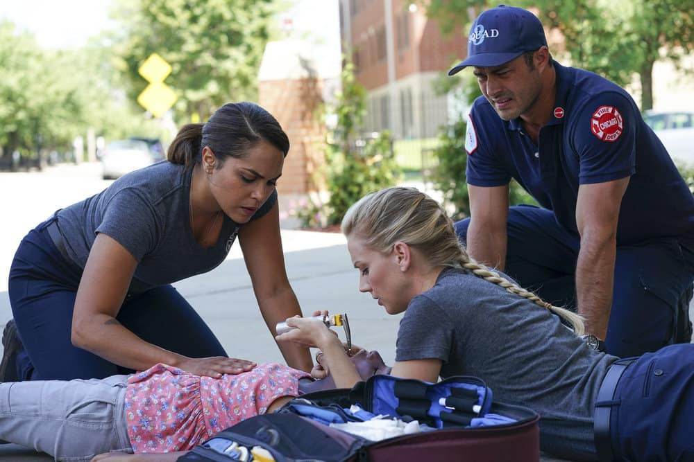 "CHICAGO FIRE -- ""It Wasn't Enough"" Episode 601 -- Pictured: (l-r) Monica Raymund as Gabriela Dawson, Vanessa Lynch as Little Girl, Kara Kilmer as Sylvie Brett, Taylor Kinney as Kelly Severide -- (Photo by: Elizabeth Morris/NBC)"