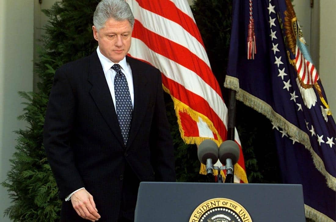 """WASHINGTON, : US President Bill Clinton walks to the podium moments before reading a statement in the Rose Garden of the White House after the Senate voted not to impeach him 12 February in Washington, DC. Clinton apologized for the actions that led to his impeachment and subsequent acquittal by the Senate, saying he was """"profoundly sorry."""" (ELECTRONIC IMAGE) AFP PHOTO/Stephen JAFFE (Photo credit should read STEPHEN JAFFE/AFP/Getty Images)"""