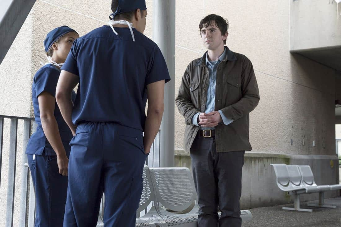 """THE GOOD DOCTOR - """"PILOT - Burnt Food"""" - Dr. Shaun Murphy (Freddie Highmore), a young surgeon with autism and savant syndrome, relocates from a quiet country life to join the prestigious St. Bonaventure hospital's surgical unit. Alone in the world and unable to personally connect with those around him, his only advocate, Dr. Aaron Glassman (Richard Schiff), challenges the skepticism and prejudices of the hospital's board and staff when he brings him in to join the team. Shaun will need to work harder than he ever has before, as he navigates his new environment and relationships to prove to his colleagues that his extraordinary medical gifts will save lives. The highly anticipated series premiere of """"The Good Doctor"""" airs MONDAY, SEPTEMBER 25 (10:01-11:00 p.m. EDT), on The ABC Television Network. (ABC/Liane Hentscher) ANTONIA THOMAS, NICHOLAS GONZALEZ, FREDDIE HIGHMORE"""