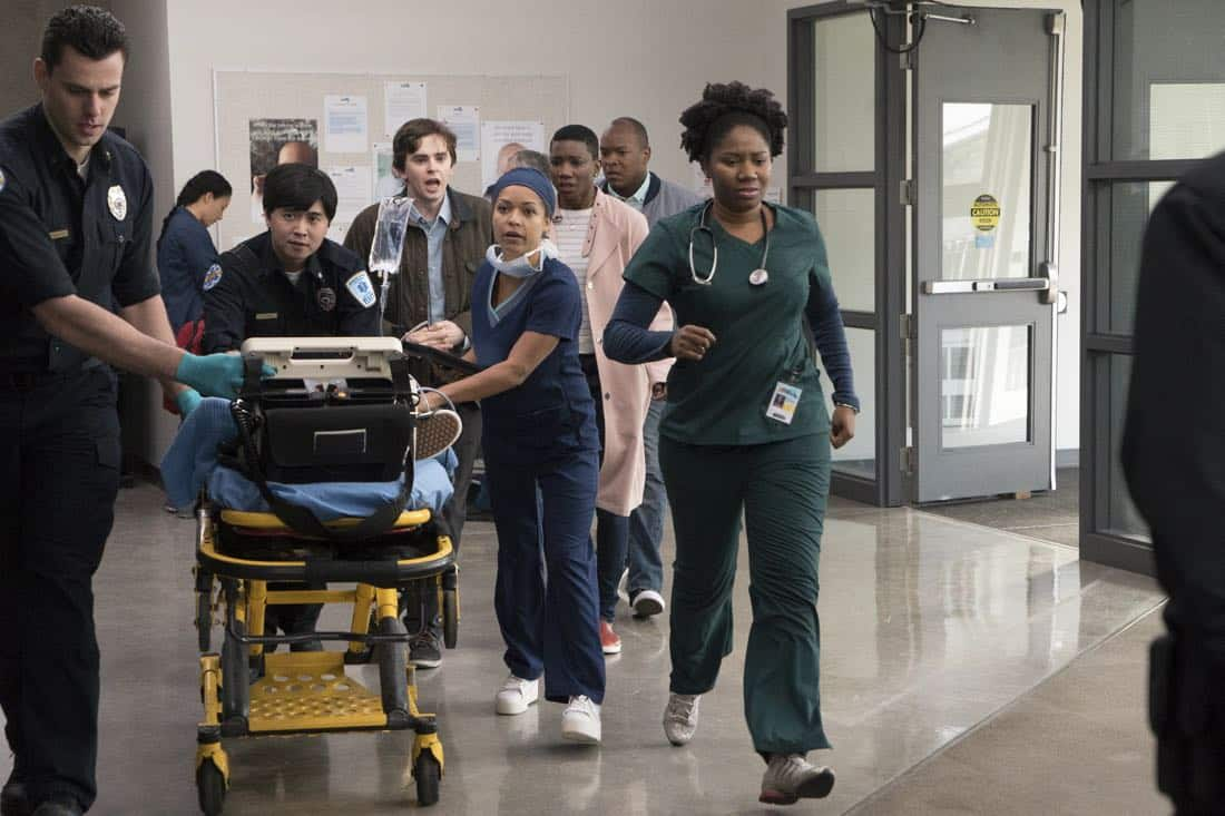 """THE GOOD DOCTOR - """"PILOT - Burnt Food"""" - Dr. Shaun Murphy (Freddie Highmore), a young surgeon with autism and savant syndrome, relocates from a quiet country life to join the prestigious St. Bonaventure hospital's surgical unit. Alone in the world and unable to personally connect with those around him, his only advocate, Dr. Aaron Glassman (Richard Schiff), challenges the skepticism and prejudices of the hospital's board and staff when he brings him in to join the team. Shaun will need to work harder than he ever has before, as he navigates his new environment and relationships to prove to his colleagues that his extraordinary medical gifts will save lives. The highly anticipated series premiere of """"The Good Doctor"""" airs MONDAY, SEPTEMBER 25 (10:01-11:00 p.m. EDT), on The ABC Television Network. (ABC/Liane Hentscher) TIM ZHANG, FREDDIE HIGHMORE, ANTONIA THOMAS"""