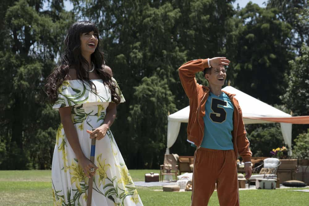 """THE GOOD PLACE -- """"Derek"""" Episode 208 -- Pictured: (l-r) Jameela Jamil as Tehani, Manny Jacinto as Jianyu -- (Photo by: Colleen Hayes/NBC)"""