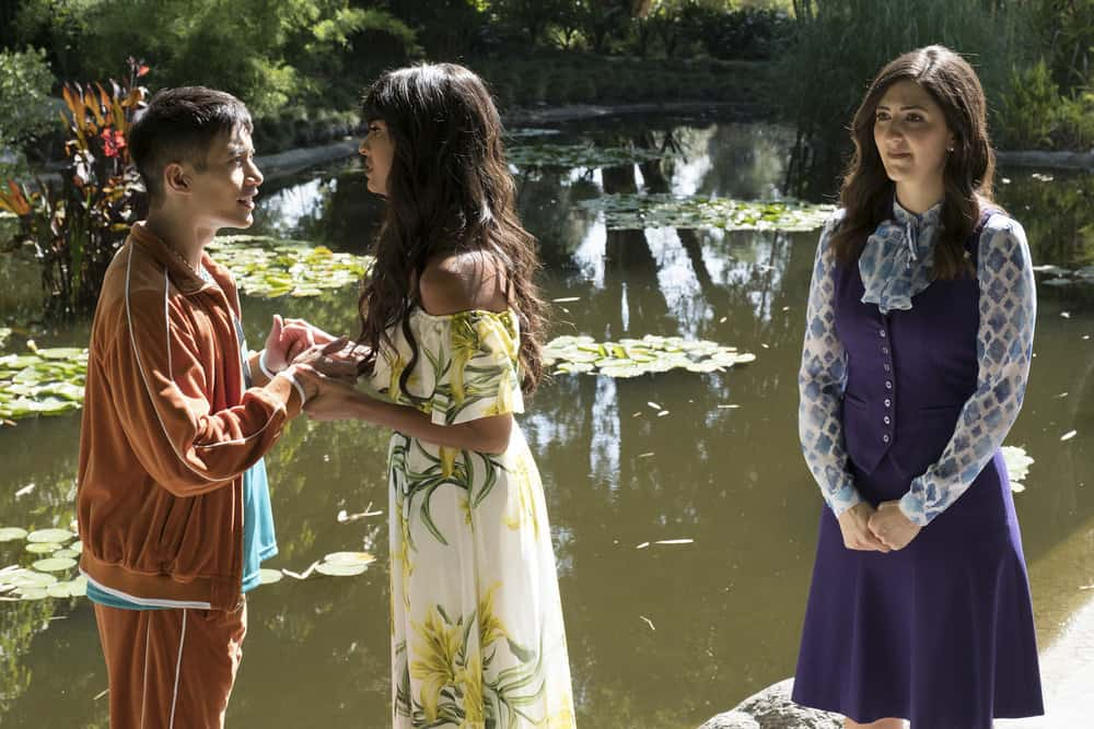 """THE GOOD PLACE -- """"Derek"""" Episode 208 -- Pictured: (l-r) Manny Jacinto as Jianyu, Jameela Jamil as Tehani, D'Arcy Carden as Janet -- (Photo by: Colleen Hayes/NBC)"""