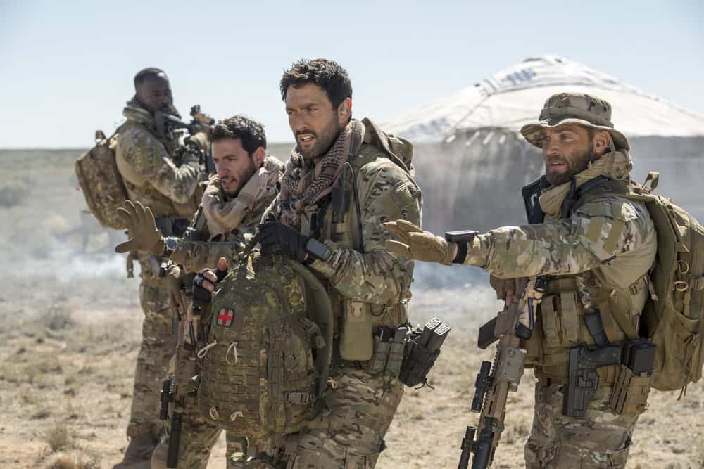 "THE BRAVE -- ""Stealth"" Episode 108 -- Pictured: (l-r) Demetrius Grosse as CPO Ezekiel ""Preach"" Carter, Hadi Tabbal as Agent Amir Al-Raisani, Noah Mills as Sergeant Joseph ""McG"" McGuire, Mike Vogel as Captain Adam Dalton -- (Photo by: Lewis Jacobs/NBC)"