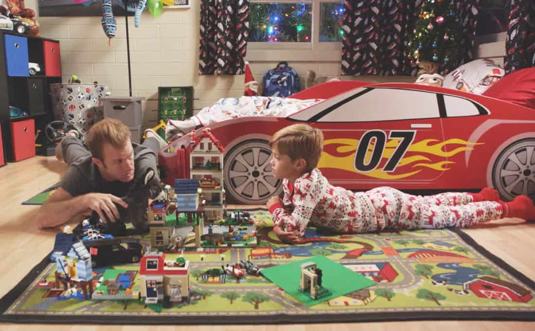 """Oni kalalea ke kū a ka lā'au loa""-- It's Christmas Eve and Danny tells Charlie a bedtime story about a recent Five-0 case involving bad Santas and a holiday miracle, on HAWAII FIVE-0, at a special time, Friday, Dec. 15 (10:00-11:00 PM, ET/PT) on the CBS Television Network. Real-life military veterans Jason Redman, Steven Jackel, Kathryn Taylor-Smith and J. Eddie Martinez guest star as veterans who help McGarrett with the case. Pictured left to right: Scott Caan as Danny ""Danno"" Williams and Zach Sulzbach as Charlie Williams. Photo credit: Screengrab/©2017 CBS Broadcasting, Inc. All Rights Reserved.     (""'Oni kalalea ke kū a ka lā'au loa"" is Hawaiian for ""A Tall Tree Stands Above the Others"")"