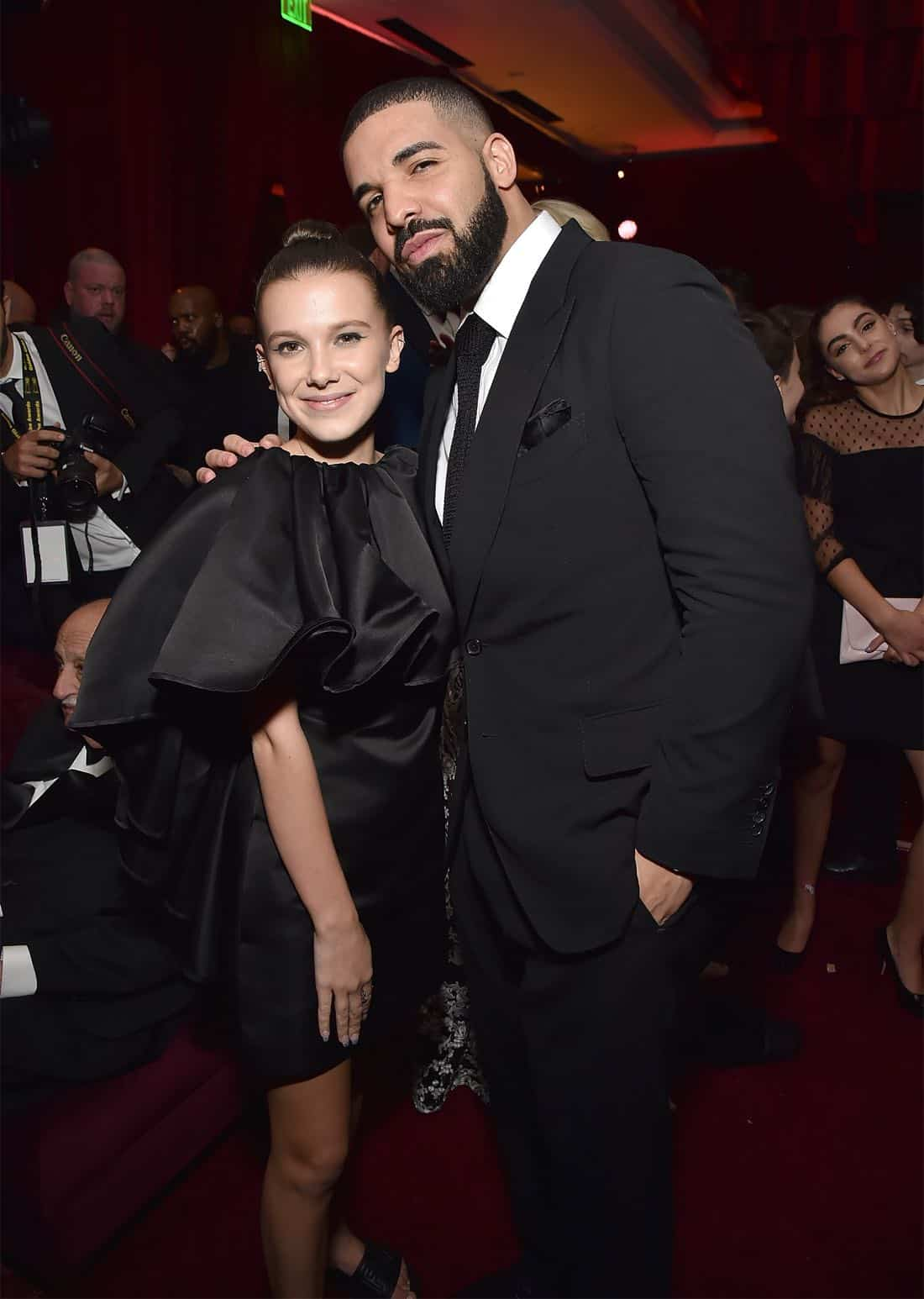 BEVERLY HILLS, CA - JANUARY 07:  Millie Bobby Brown and Drake attend the Netflix Golden Globes after party at Waldorf Astoria Beverly Hills on January 7, 2018 in Beverly Hills, California.  (Photo by Kevin Mazur/Getty Images for Netflix) *** Local Caption *** Millie Bobby Brown; Drake