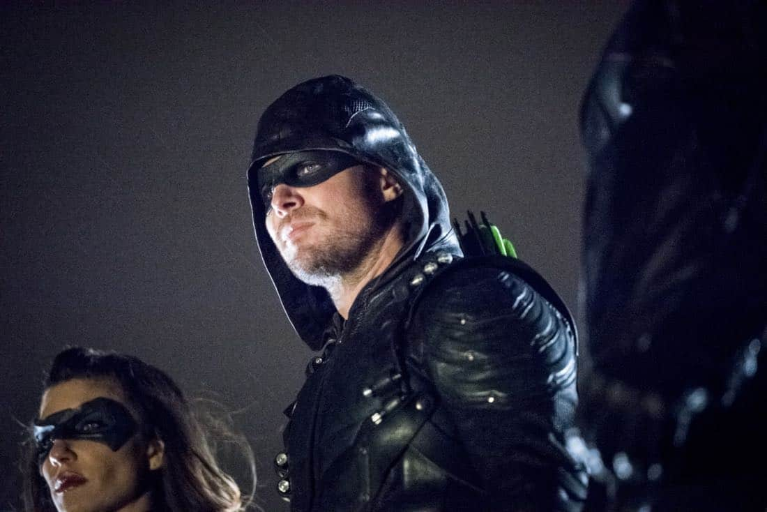 """Arrow -- """"We Fall"""" -- Image Number: AR611a_0235.jpg -- Pictured (L-R): Juliana Harkavy as Dinah Drake/Black Canary and Stephen Amell as Oliver Queen/Green Arrow -- Photo: Dean Buscher/The CW -- © 2018 The CW Network, LLC. All Rights Reserved."""