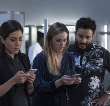 "BLINDSPOT -- ""Technology Wizards"" Episode 311 -- Pictured: (l-r) Audrey Esparza as Tasha Zapata, Ashley Johnson as Patterson, Ennis Esmer as Rich Dotcom -- (Photo by: Eric Liebowitz/NBC)"