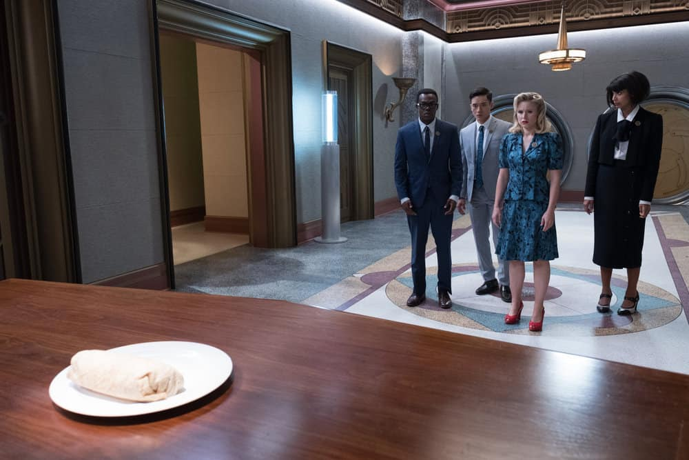 """THE GOOD PLACE -- """"The Burrito"""" Episode 212 -- Pictured: (l-r) William Jackson Harper as Chidi, Manny Jacinto as Jianyu, Kristen Bell as Eleanor, Jameela Jamil as Tahani -- (Photo by: Colleen Hayes/NBC)"""