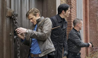 """""""Murdoc + Handcuffs"""" -- After one of Murdoc's go-to assassins agrees to hand over Murdoc to MacGyver in exchange for $10 million, the team finds itself protecting Murdoc from his former mentor, Nicholas Helman, who wants him dead. Also, Jack realizes he may still have feelings for Riley's mother, Diane (Michael Michele), on MACGYVER, Friday, Feb. 2 (8:00-9:00 PM ET/PT) on the CBS Television Network. Michael Des Barres, who played Murdoc in the original """"MacGyver"""" series, guest stars as Murdoc's mentor, Nicholas Helman. Pictured: Lucas Till, David Dastmalchian, George Eads. Photo: Annette Brown/CBS ©2017 CBS Broadcasting, Inc. All Rights Reserved"""