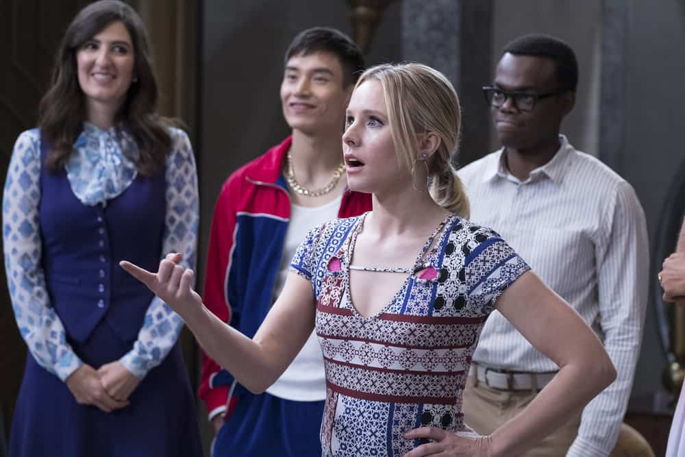 """THE GOOD PLACE -- """"Somewhere Else"""" Episode 213 -- Pictured: (l-r) D'Arcy Carden as Janet, Manny Jacinto as Jianyu, Kristen Bell as Eleanor, William Jackson Harper as Chidi -- (Photo by: Colleen Hayes/NBC)"""