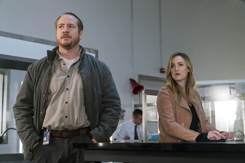 "BLINDSPOT -- ""Two Legendary Chums"" Episode 312 --  Pictured: (l-r) Darren Goldstein as Donald Shipley, Ashley Johnson as Patterson -- (Photo by: David Giesbrecht/NBC/Warner Bros.)"