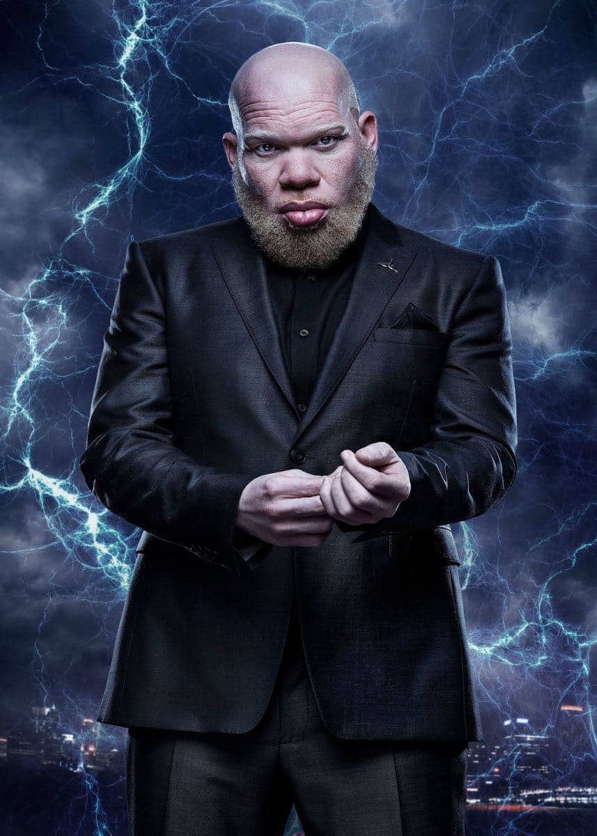 """Black Lightning -- Image BLK_SINGLES_TOBIAS.jpg -- Pictured: Marvin """"Krondon"""" Jones III as Tobias -- Photo: Mark Hill/The CW -- © 2018 The CW Network, LLC. All rights reserved"""