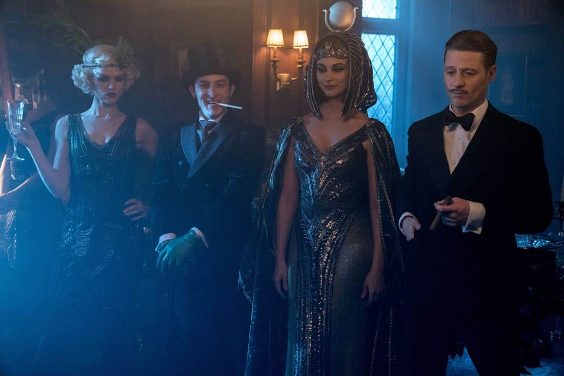 "GOTHAM: L-R: Erin Richards, Robin Lord Taylor, Morena Baccarin and Ben McKenzie in the ""A Dark Knight: A Beautiful Darkness"" episode of GOTHAM airing Thursday, March 8 (8:00-9:00 PM ET/PT) on FOX.  ©2018 Fox Broadcasting Co. Cr: David Giesbrecht/FOX"