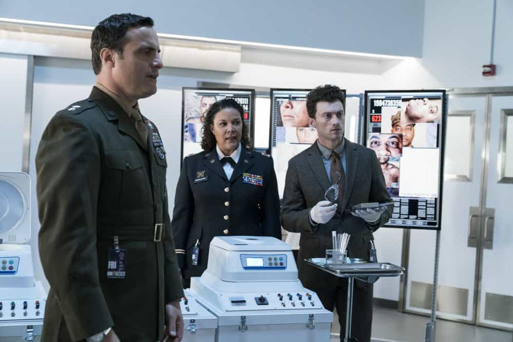"BLINDSPOT -- ""Everlasting"" Episode 314 -- Pictured: (l-r) Dominic Fumusa as Gen. Peter Mahoney, Linda Powell as Col. Sara Ferguson, Bryce Pinkham as Jack Izenberg -- (Photo by: David Giesbrecht/NBC)"