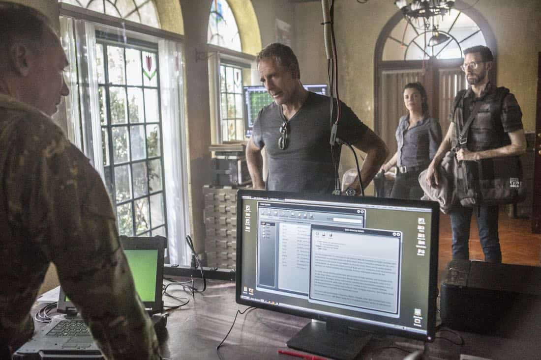 """Welcome to the Jungle"" -- Pride, Sebastian and Tammy travel to South America after Pride is personally requested by a former colleague to assist with a classified operation that has been compromised, on NCIS: NEW ORLEANS, Tuesday, March 27 (10:00-11:00 PM, ET/PT) on the CBS Television Network. Pictured L-R: Patrick Page as Colonel Stanley Parker, Scott Bakula as Special Agent Dwayne Pride, Vanessa Ferlito as FBI Special Agent Tammy Gregorio, and Rob Kerkovich as Forensic Scientist Sebastian Lund Photo: Skip Bolen/CBS ©2018 CBS Broadcasting, Inc. All Rights Reserved"