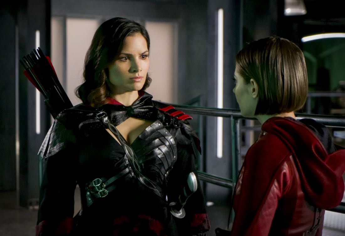 "Arrow -- ""The Thanatos Guild"" -- Image Number: AR616a_0311.jpg -- Pictured (L-R): Katrina Law as Nyssa Al-Ghul and Willa Holland as Thea Queen/Speedy -- Photo: Shane Harvey/The CW -- © 2018 The CW Network, LLC. All rights reserved."