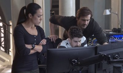 "TAKEN -- ""Strelochnik"" Episode 208 -- Pictured: (l-r) Jessica Camacho as Santana, Adam Goldberg as Kilroy, Clive Standen as Bryan Mills -- (Photo by: Panagiotis Pantazidis/NBC)"