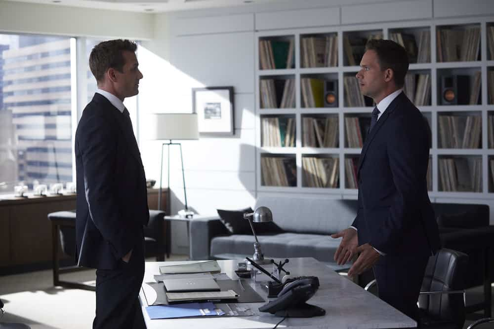SUITS -- Episode 711 -- Pictured: (l-r) Gabriel Macht as Harvey Spector, Patrick J. Adams as Mike Ross -- (Photo by: Shane Mahood/USA Network)