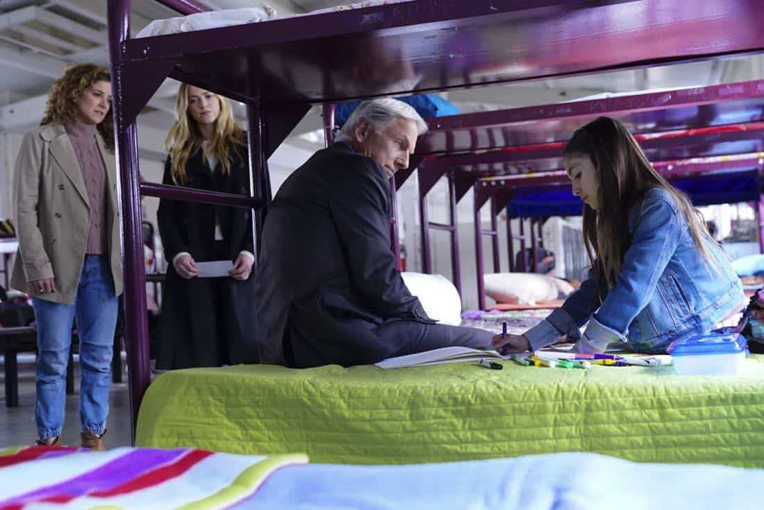 """The Numerical Limit"" -- Gibbs is granted protective custody of a 10-year-old orphaned refugee, Elena (Lily Rose Silver), when an NCIS case reveals she is the target of a violent gang, on NCIS, Tuesday, April 3 (8:00-9:00 PM, ET/PT) on the CBS Television Network. Pictured: Alexis Carra, Emily Wickersham, Mark Harmon, Lily Rose Silver Photo: Sonja Flemming/CBS ©2018 CBS Broadcasting, Inc. All Rights Reserved"