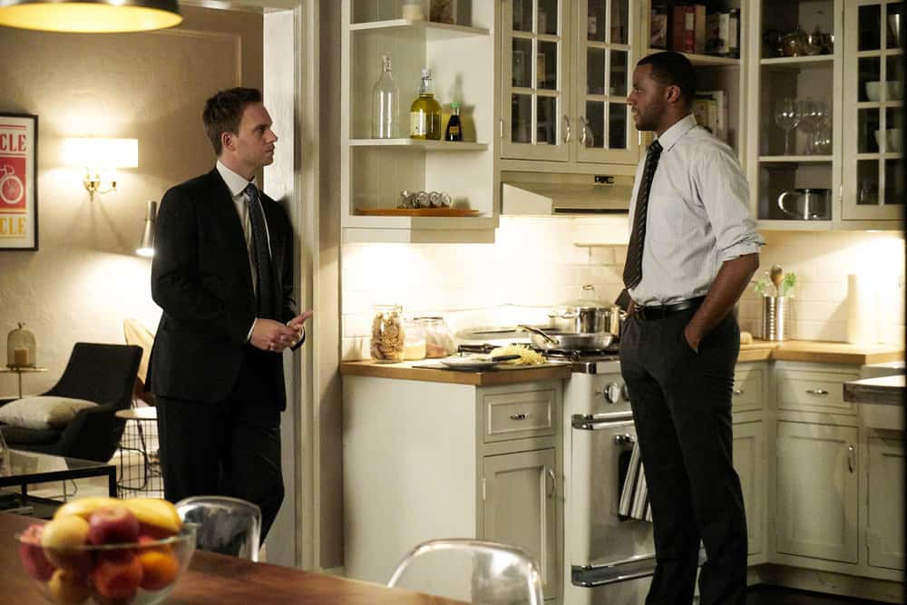 """SUITS -- """"Bad Man"""" Episode 712 -- Pictured: (l-r) Patrick J. Adams as Mike Ross, Jordan Johnson-Hinds as Oliver Grady -- (Photo by: Ian Watson/USA Network)"""