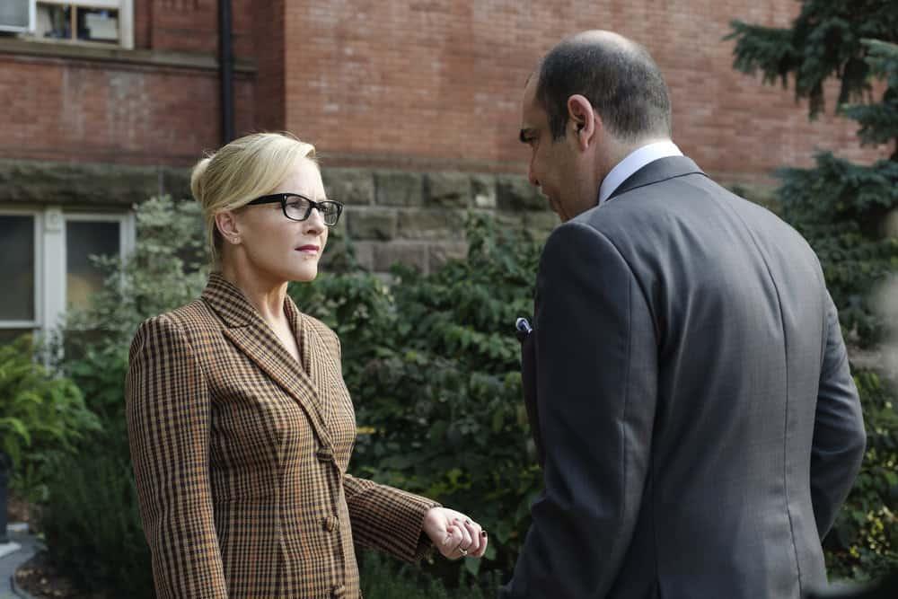 "SUITS -- ""Bad Man"" Episode 712 -- Pictured: (l-r) Rachael Harris as Sheila Sazs, Rick Hoffman as Louis Litt -- (Photo by: Christos Kalohoridis/USA Network)"