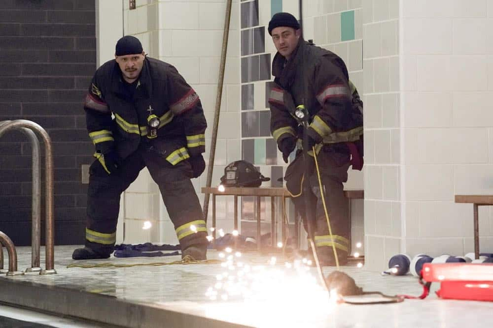 "CHICAGO FIRE -- ""Put White On Me"" Episode 617 -- Pictured: (l-r) Joe Minoso as Joe Cruz, Taylor Kinney as Kelly Severide -- (Photo by: Elizabeth Morris/NBC)"