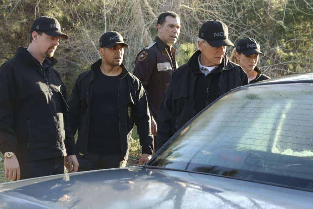 """""""Sight Unseen"""" -- NCIS searches for a petty officer suspected of assault who escapes when the sheriff transporting him crashes into a lake. Also, Torres works closely with Annie Barth (Marilee Talkington), a key blind witness who heard vital evidence needed to solve the case, on the milestone 350th episode of NCIS, Tuesday, April 17 (8:00-9:00 PM, ET/PT) on the CBS Television Network. Pictured: Sean Murray, Wilmer Valderrama, Mark Harmon, Emily Wickersham. Photo: Patrick McElhenney/CBS ©2018 CBS Broadcasting, Inc. All Rights Reserved"""